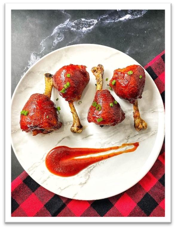 Delicious chicken drumsticks with Best Damn BBQ sauce