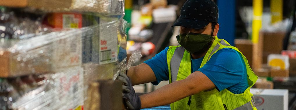 KeHE warehouse employee moving a pallet