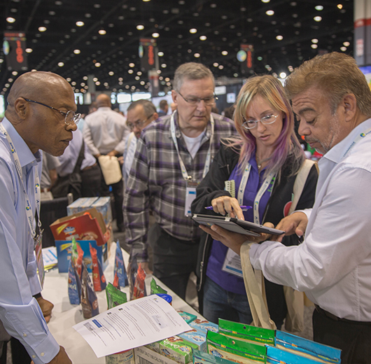 KeHE show attendees ordering at an exhibitor booth